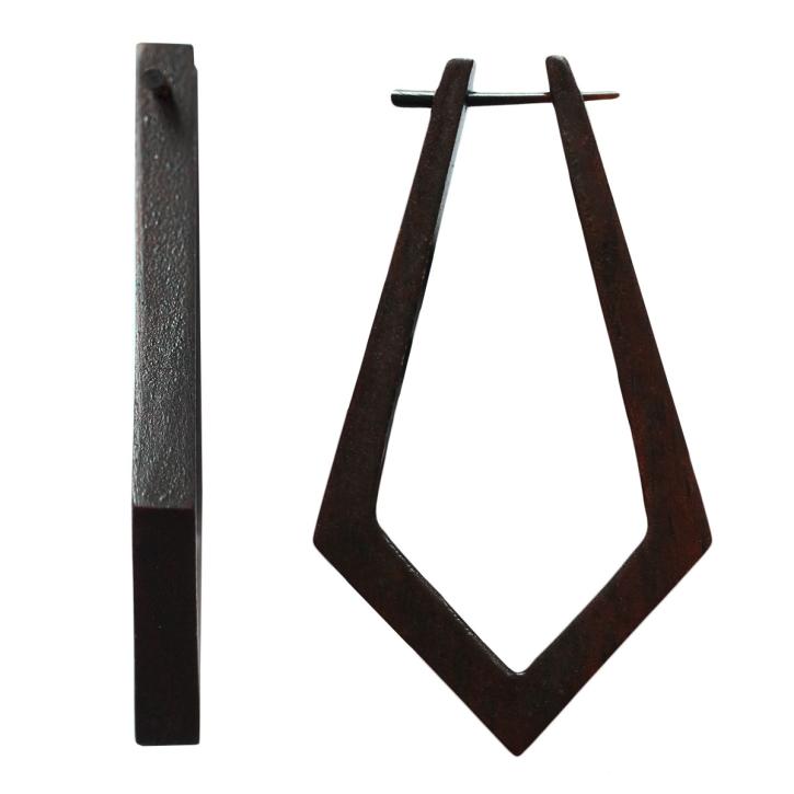 Drachenförmiger Holzohrstecker aus schwarzem Palisanderholz
